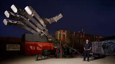 The Hand of Man, a 26-foot-long arm controlled