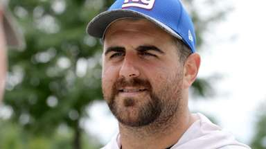 Giants lineman John Greco talks to a reporter