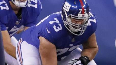 Giants center John Greco waits to snap during