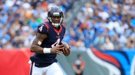 Deshaun Watson #4 of the Houston Texans runs