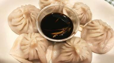 Shanghai-style soup dumplings are an appetizer at Master
