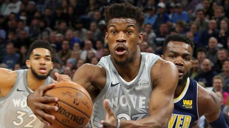 Jimmy Butler drives as the Nuggets' Paul Millsap
