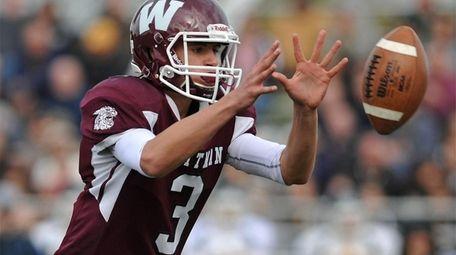 Quinn O'Hara #3, Whitman quarterback, takes a snap