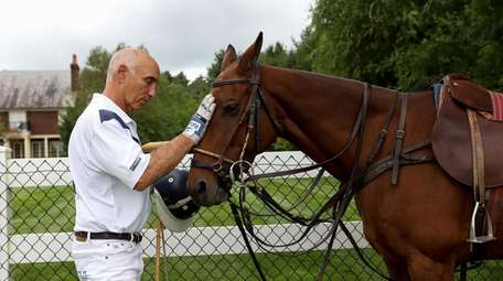 Polo player and coach Robert Ceparano with Lorenzo,