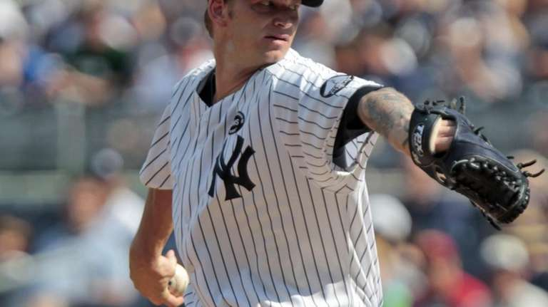 New York Yankees' A.J. Burnett delivers a pitch