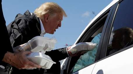 President Donald Trump hands out food outside Temple