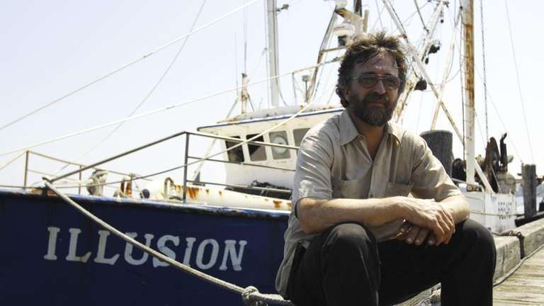 Boat owner Mark Phillips sits in front of