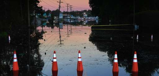 A street remains flooded at sunrise Wednesday in