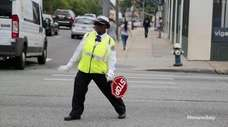 Shirley Cunningham, a 14-year-veteran school crossing guard in