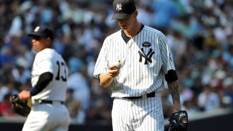 Yankees starting pitcher A.J. Burnett looks at his