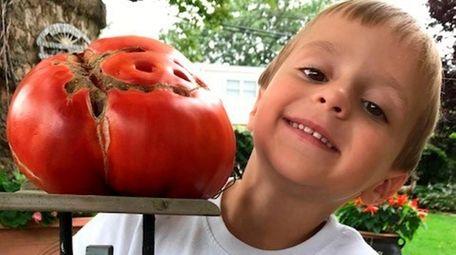 """Wyatt DePace, 4, """"loves taking care"""" of tomato"""