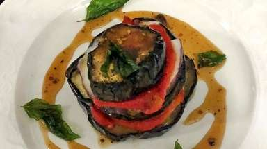 Anitpasti of grilled eggplant with goat cheese, red