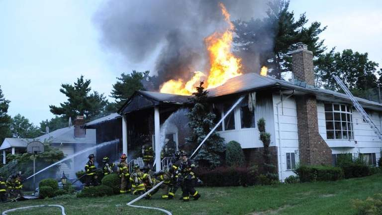 A house fire burns early Monday morning on