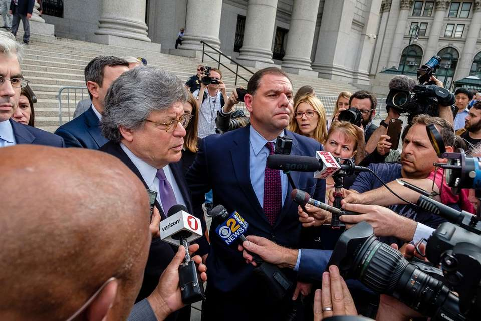 Joseph Percoco, center, in red tie, leaves the