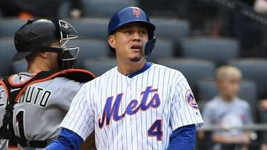 The Mets' Wilmer Flores reacts after striking out