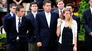 James and Daphne Malone, front, attend the funeral