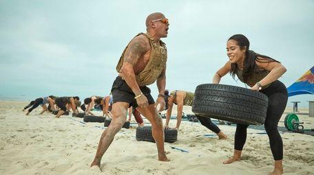 Fitness instructor Tony Hernandez runs a bootcamp on