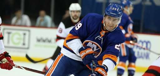 Islanders' Brock Nelson skates up the ice during