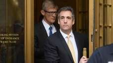 Michael Cohen, second from right, exits a federal