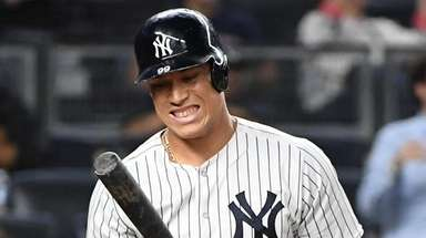 Yankees rightfielder Aaron Judge reacts after striking out