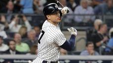 New York Yankees' Giancarlo Stanton watches his grand