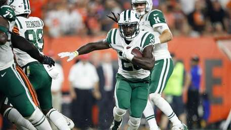 Jets' Isaiah Crowell looks for running room against