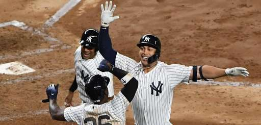 Yankees DH Giancarlo Stanton celebrates his grand slam