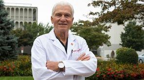 Dr. Frank Bonura stands outside St. Catherine of