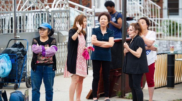 Neighbors outside the residence on 161st Street in
