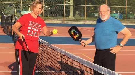 Elizabeth and Michael Katz on the pickleball court