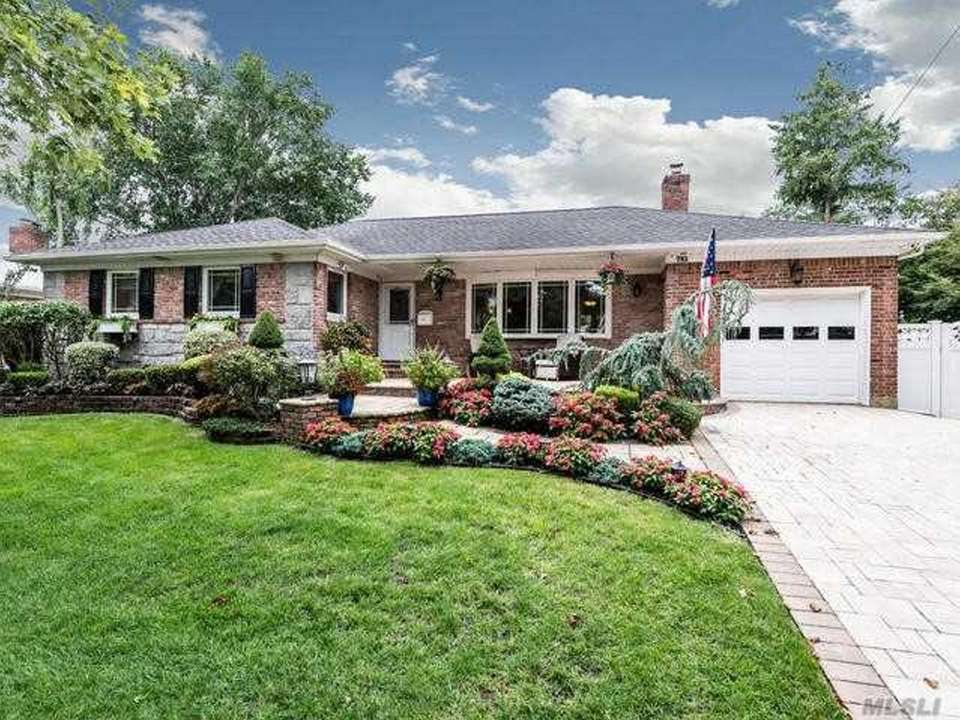 This Westbury ranch includes three bedrooms and four