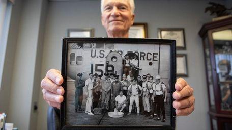 Dr. Frank Bonura shows a photo of himself