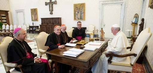 Pope Francis (L) talking with Cardinal Daniel DiNardo