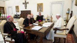 Pope Francis (L) talking with Cardinal Daniel DiNardo