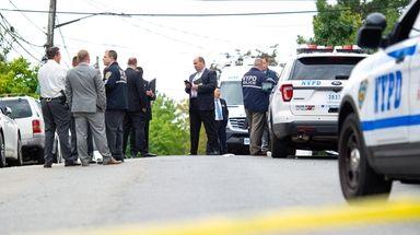 Police at the shooting scene in East Elmhurst,