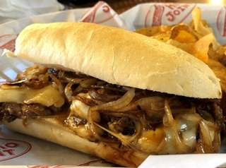 A cheesesteak and house-made salt and pepper chips