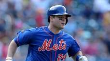 Mets catcher Devin Mesoraco rounds the bases after