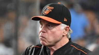 Baltimore Orioles manager Buck Showalter looks on from