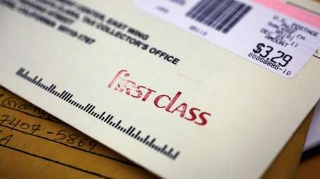 A first-class envelope at a post office in