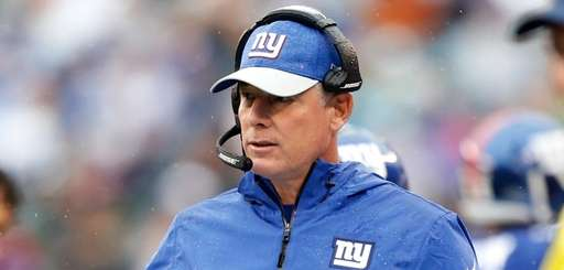 Giants coach Pat Shurmur looks on from the