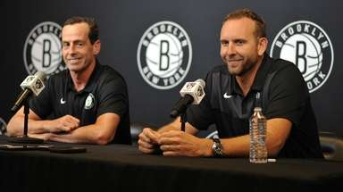 Brooklyn Nets General Manager Sean Marks, right, and
