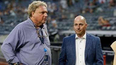 New York Yankees president Randy Levine (L) and