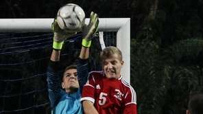 Jericho's goalkeeper Jake Levy goes up for the