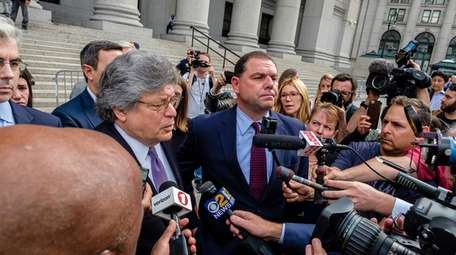 Joseph Percoco, center, leaves the federal courthouse in
