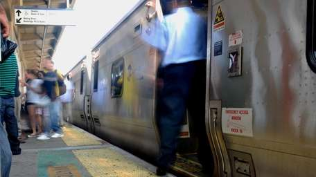 A Long Island Rail Road conductor holds the