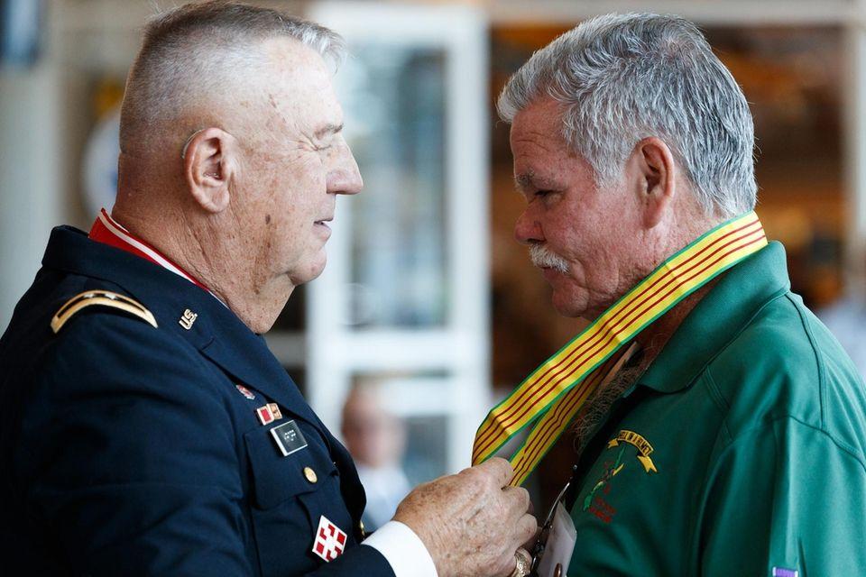 Marine veteran Lawrence Noon is presented a Vietnam