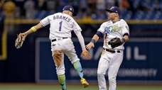 Tampa Bay Rays shortstop Willy Adames, left,