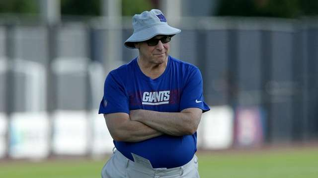 New York Giants general manager Dave Gettleman watches