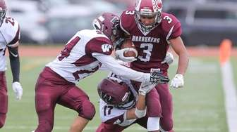 Bay Shore's Jalen Thompson carries the ball and