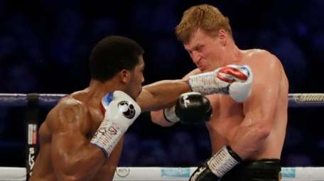 British boxer Anthony Joshua, left, fights Russian boxer